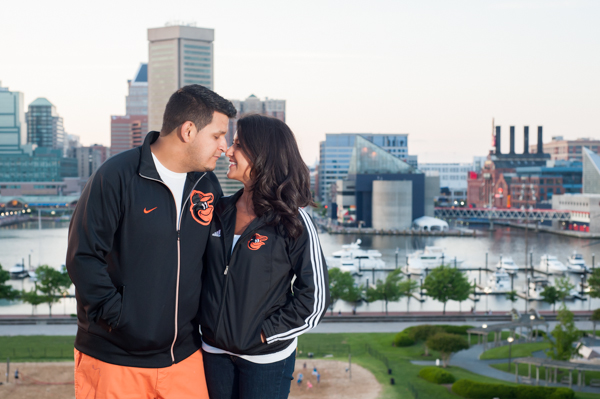 Couple wearing Orioles jackets in Baltimore  ||  What to wear for your engagement session  ||  Jennifer Smutek Photography  ||   Charm City Wed  ||   www.charmcitywed.com