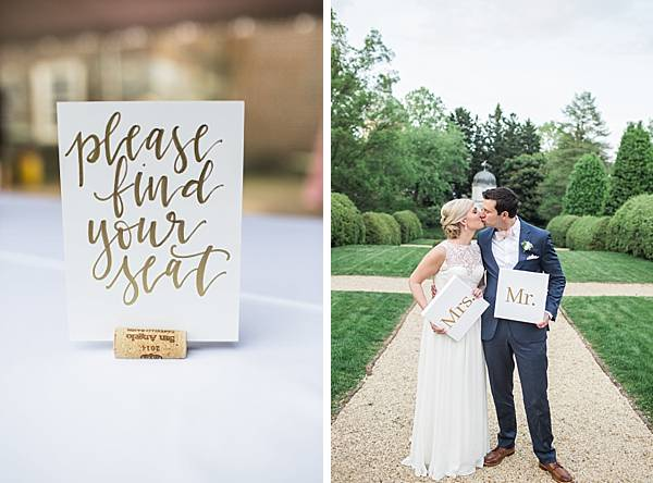Gold table cards placed inside a wine cork. The bride and groom holding Mr. & Mrs. signs at their Annapolis Wedding Venue.
