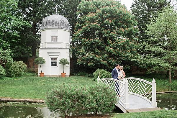 Beautiful covered bridge at the ceremony location at William Paca House. Image by Tara & Renata photography