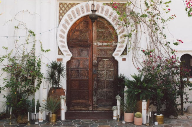 This wild and wayward framing of the door piques interest and provides a glimpse of what's ahead for the wedding day. Credit: Sposto Photography